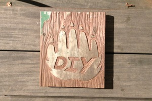 DIY carved logo from salvaged wood