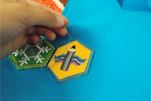 Sewing on skill patches
