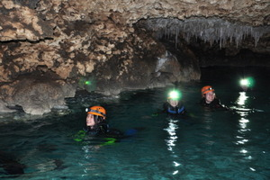 Spelunking in an underground river