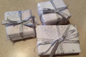 Snowflake-stamped gift wrap