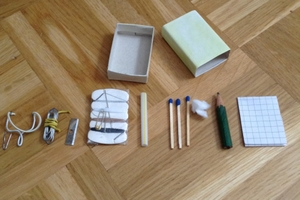Survival kit that fits into a matchbox